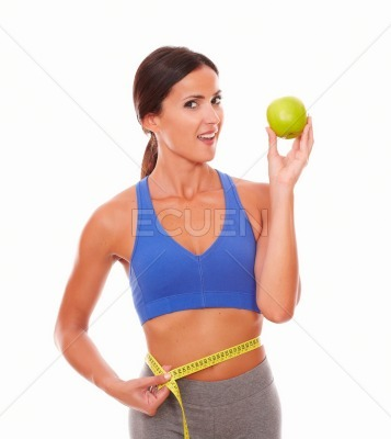 Fit woman on a diet showing apple