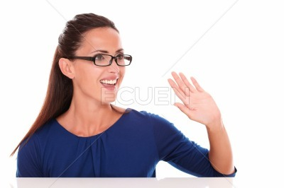 Friendly girl with glasses gesturing a greeting