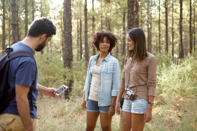 Friends discussing something while out hiking