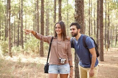 Friends pointing at something in forest