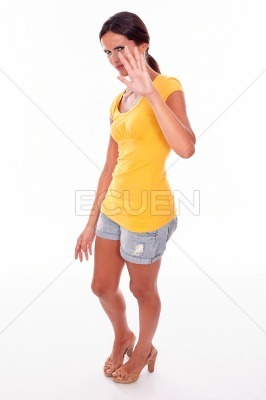 Frowning brunette woman gesturing on white