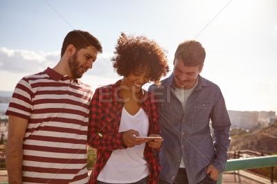 Fun loving friends with a cell phone