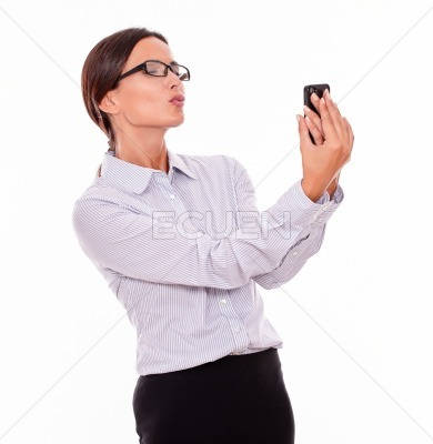 Happy brunette businesswoman with cell phone