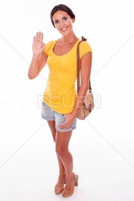 Happy smiling young brunette with handbag