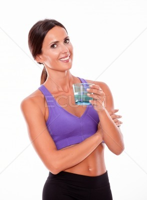 Healthy brunette with a glass of water