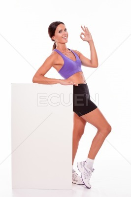 Healthy satisfied brunette with blank placard