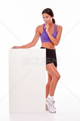 Healthy smiling brunette holding blank placard