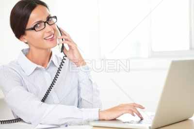 Hispanic female employee conversing on the phone