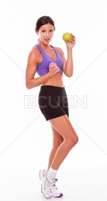In shape brunette woman lifting weight