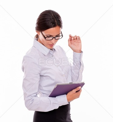 Interested brunette woman looking at tablet
