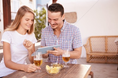 Interested young couple looking at tablet