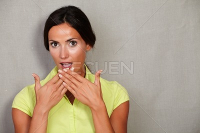 Lady looking surprised with hands to mouth