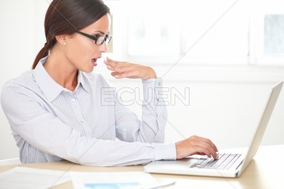 Lady secretary with glasses working on desk