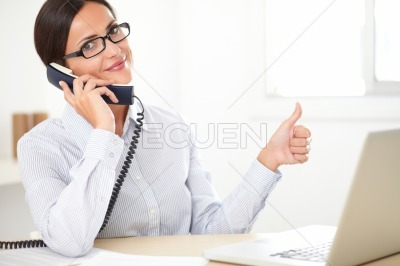 Latin employee happily doing customer service