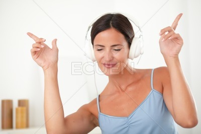 Latin female dancing while listening to music