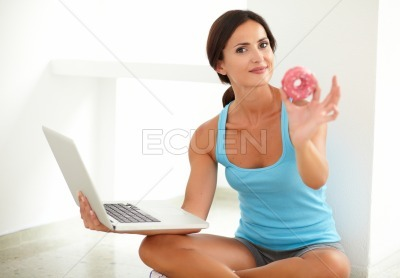 Latin woman on diet working in her laptop