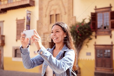 Long haired girl taking a picture