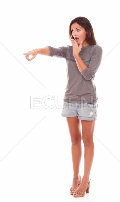 Lovely female in shorts standing up pointing