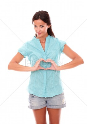 Lovely female making a love sign with hands