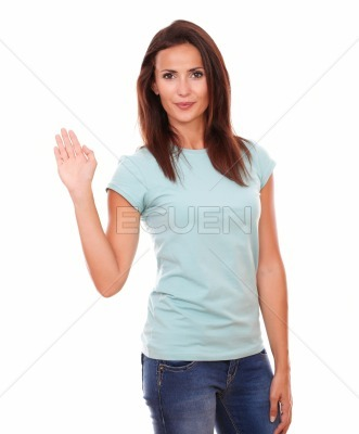 Lovely latin woman with greeting hand