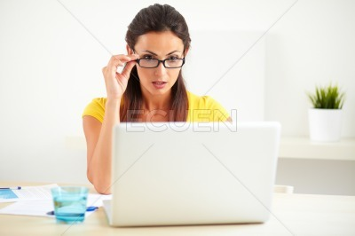 Lovely secretary surfing the web on computer