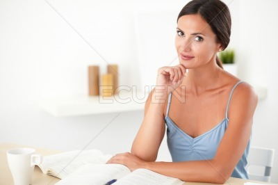 Lovely stylish woman studying her books