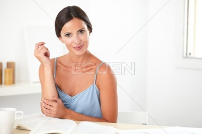 Lovely woman sitting while studying books
