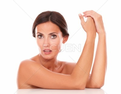 Mature latin woman touching her hands