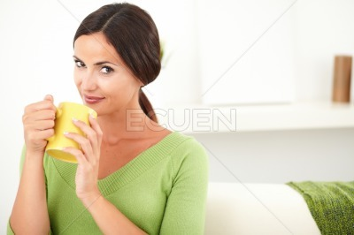 Peaceful caucasian woman holding a mug