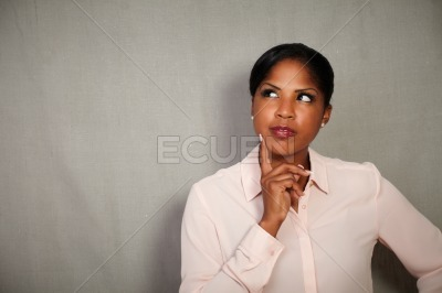 Pensive businesswoman planning while looking away
