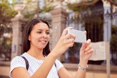 Picture taking girl with cell phone