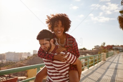 Playful couple doing the piggy back
