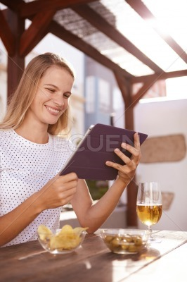 Pretty blond looking at her tablet