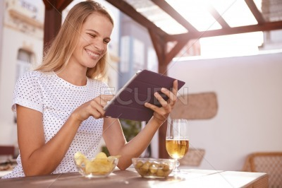 Pretty blond pointing at her tablet