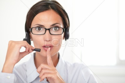 Pretty employee speaking on the headset
