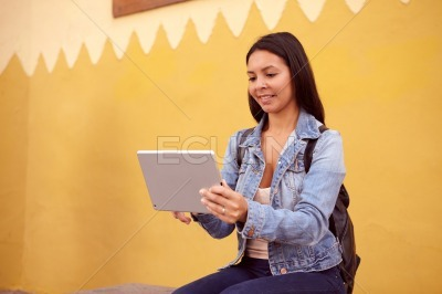 Pretty girl sitting with a tablet pc