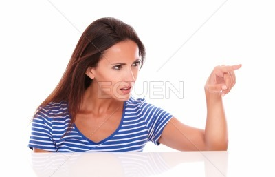 Pretty lady in blue t-shirt gesturing selecting