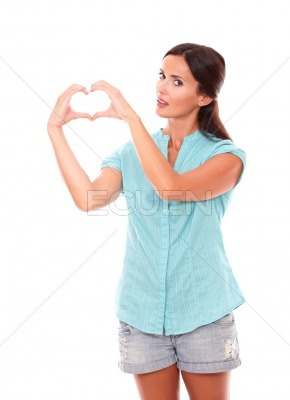 Pretty lady making a love sign with hands