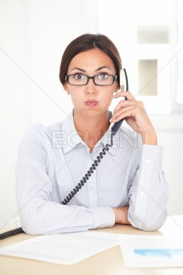 Pretty receptionist calling on the phone