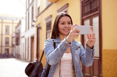 Pretty smiling young girl taking a picture