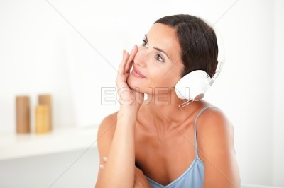 Pretty woman smiling while listening to music