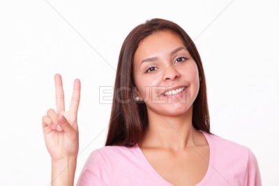 Pretty young girl with victory fingers