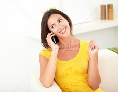 Relaxed lady talking on her mobile phone