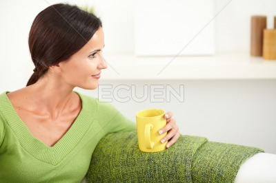 Relaxed woman sitting and looking away
