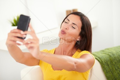 Relaxed young woman taking a selfie