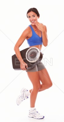 Satisfied lady holding weight scale on right hand