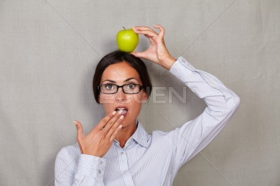 Shocked lady with apple on head and open mouth