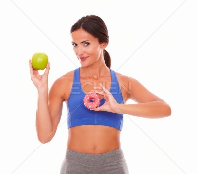 Slim lady in training clothes holding food