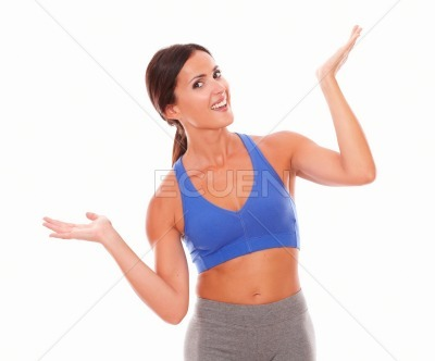 Slim young woman raising both palms with vitality