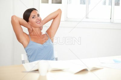 Smart woman looking satisfied and relaxed